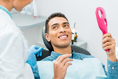 man smiling after having his teeth whitened in Denver, CO