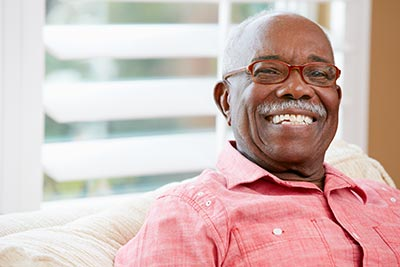 man smiling with his new dental implants